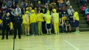 The Negaunee Miner student section displays a wide array of gear to support their team.