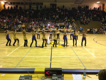 The dance team takes the floor as the student section preps to cheer on their Miners.
