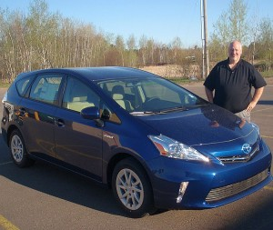 David McClelland of Riverside Marquette with a new 2013 Toyota Prius-V.