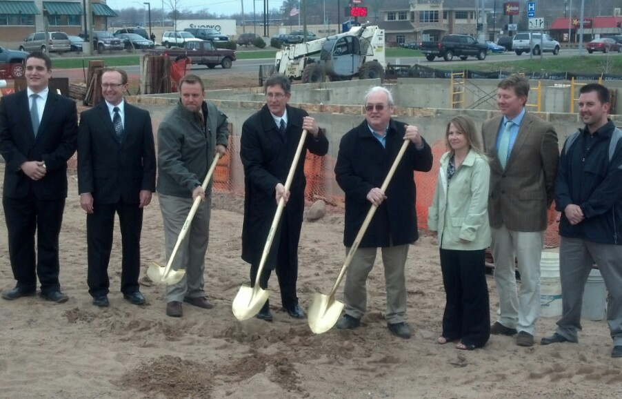 Officials with Peninsula Bank and Integrated Designs break ground for new Pen Bank branch at the corner of McClellan and Baraga in Marquette